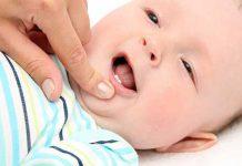 دلیل دیر دندان درآوردن نوزاد